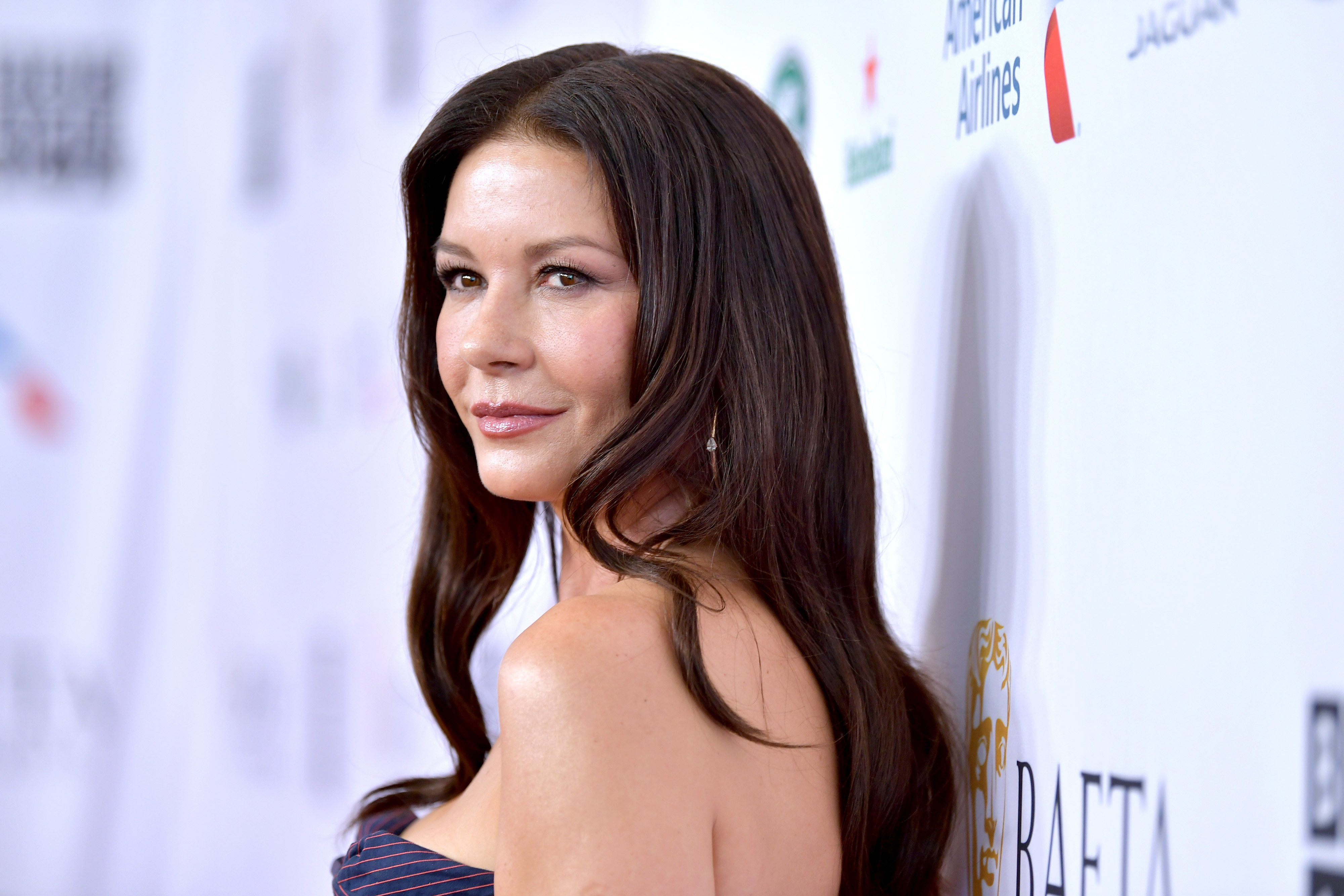 Image Credits: Getty Images / Amy Sussman | Catherine Zeta-Jones attends the BAFTA Los Angeles + BBC America TV Tea Party 2019 at The Beverly Hilton Hotel on September 21, 2019 in Beverly Hills, California.