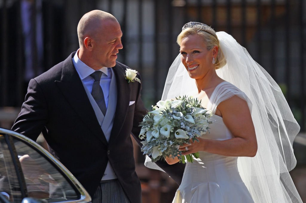 Image Credit: Getty Images / Mike Tindall and Zara Phillips depart after their Royal wedding at Canongate Kirk on July 30, 2011 in Edinburgh, Scotland.