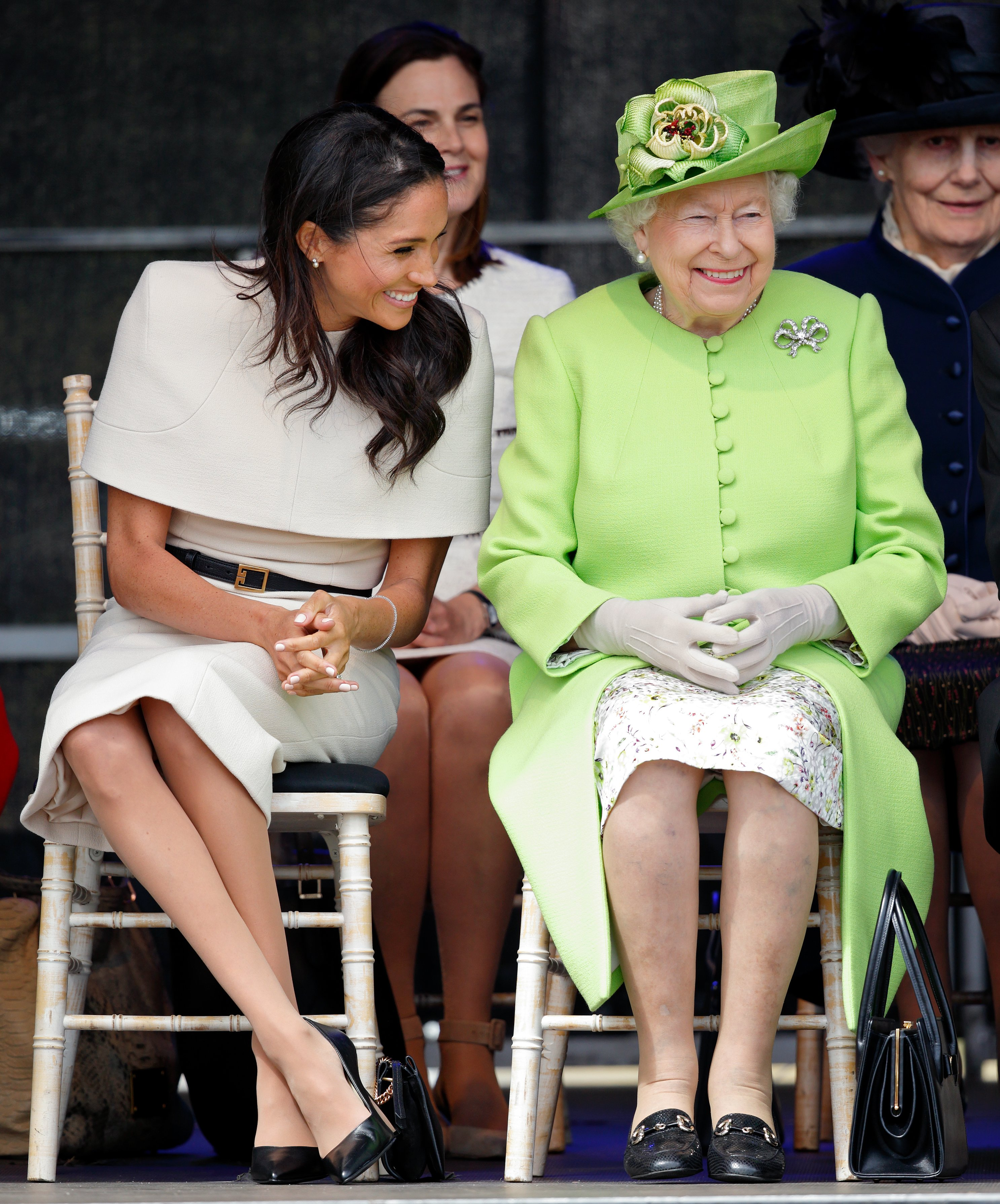 Image Credits: Getty Images / Max Mumby / Indigo   Meghan, Duchess of Sussex and Queen Elizabeth II attend a ceremony to open the new Mersey Gateway Bridge on June 14, 2018 in Widnes, England. Meghan Markle married Prince Harry last month to become The Duchess of Sussex and this is her first engagement with the Queen. During the visit the pair will open a road bridge in Widnes and visit The Storyhouse and Town Hall in Chester.