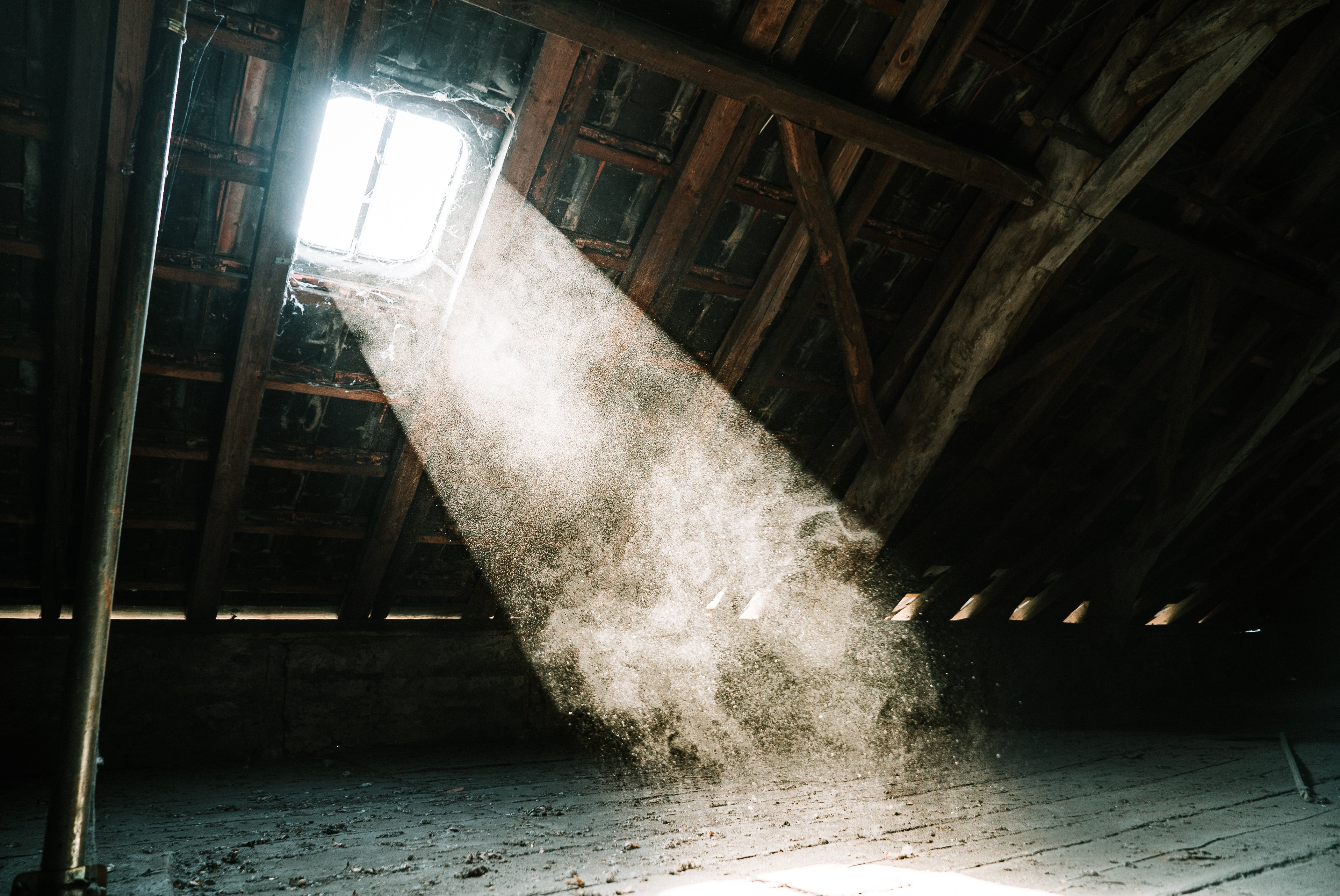 Light shining in to an attic | Photo by Mika Baumeister on Unsplash