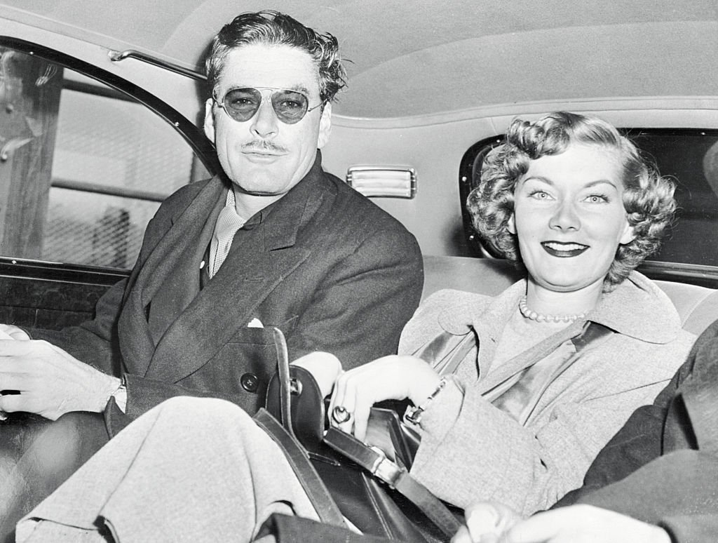 Image Source: Getty Images/Bettmann/Errol Gets Fair Consolation. New York: While his wife, Nora Eddington, is in Nevada preparing to unhitch her wagon from the star, Errol Flynn