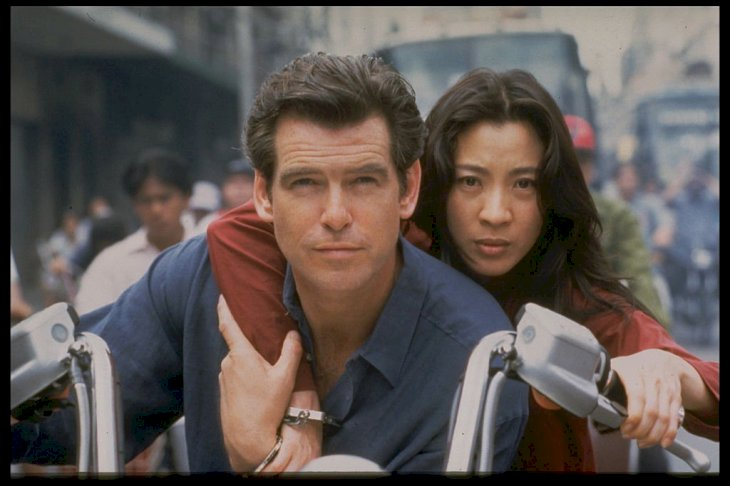 Image Credit: Getty Images / Michelle Yeoh with her James Bond, Pierce Brosnan.