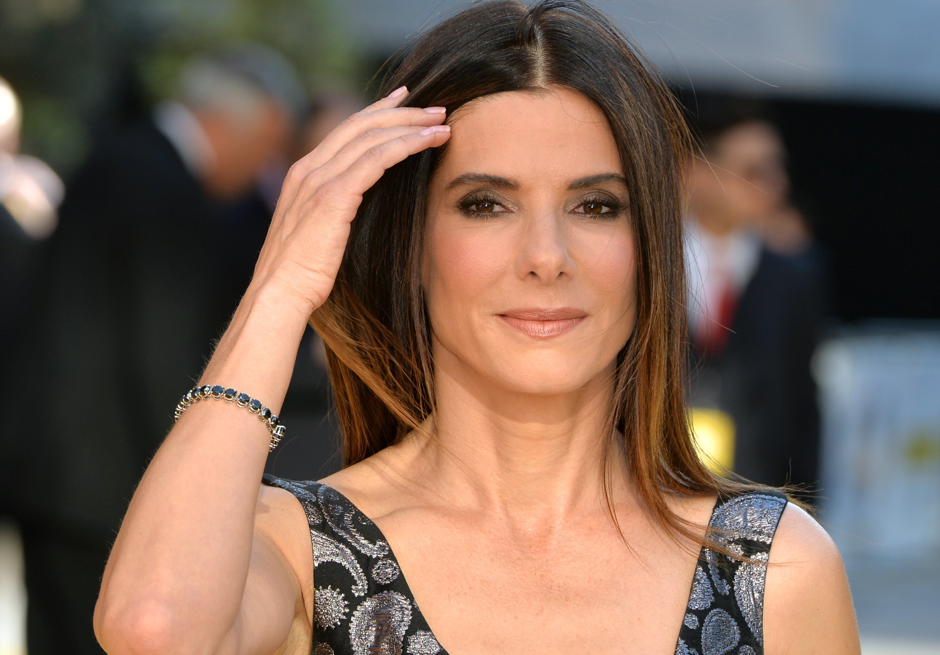 "Image Credits: Getty Images / Anthony Harvey | Sandra Bullock attends the World Premiere of ""Minions"" at Odeon Leicester Square on June 11, 2015 in London, England."