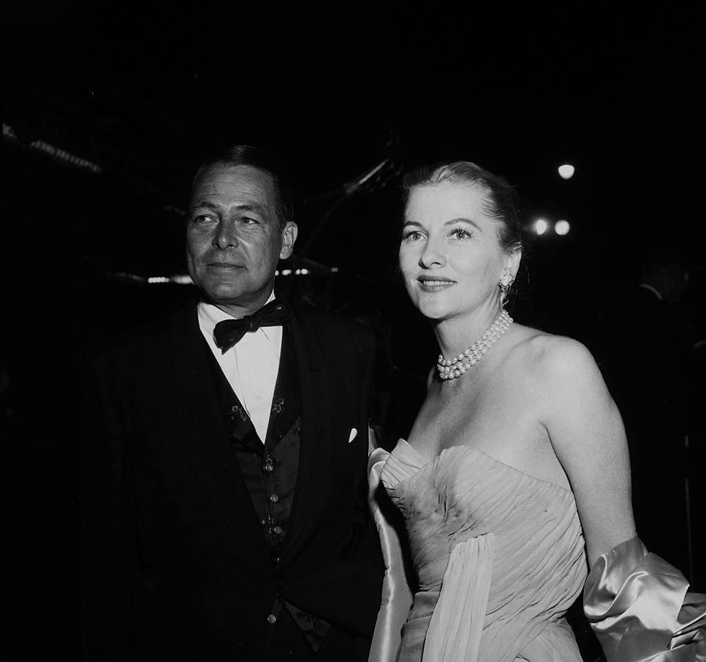 Image Source:Getty Images/Michael Ochs Archives/Earl Leaf/Joan Fontaine and husband Collier Young attend at party in 1957