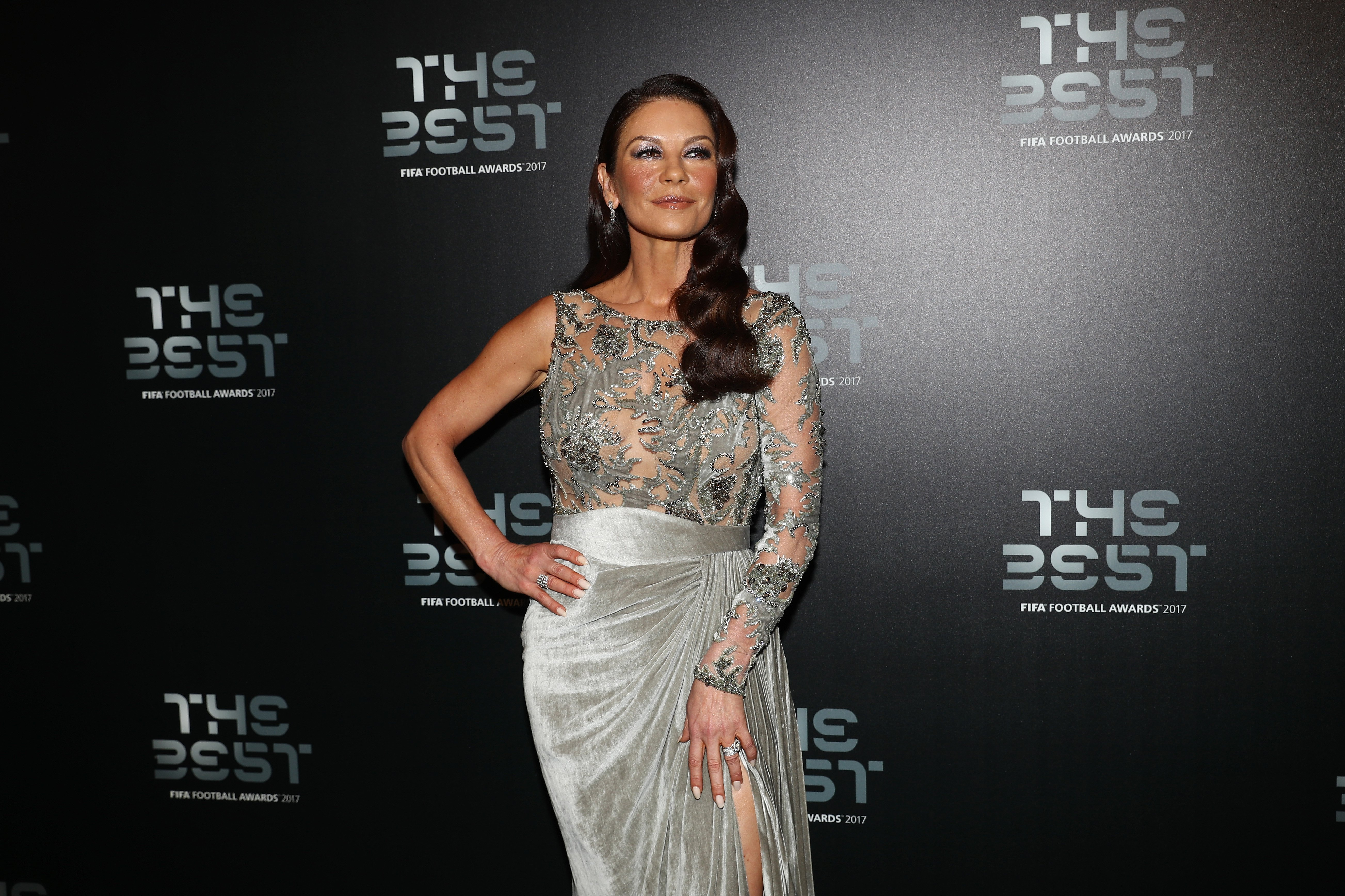 Image Credits: Getty Images / Michael Steele | Catherine Zeta Jones arrives for The Best FIFA Football Awards - Green Carpet Arrivals on October 23, 2017 in London, England.