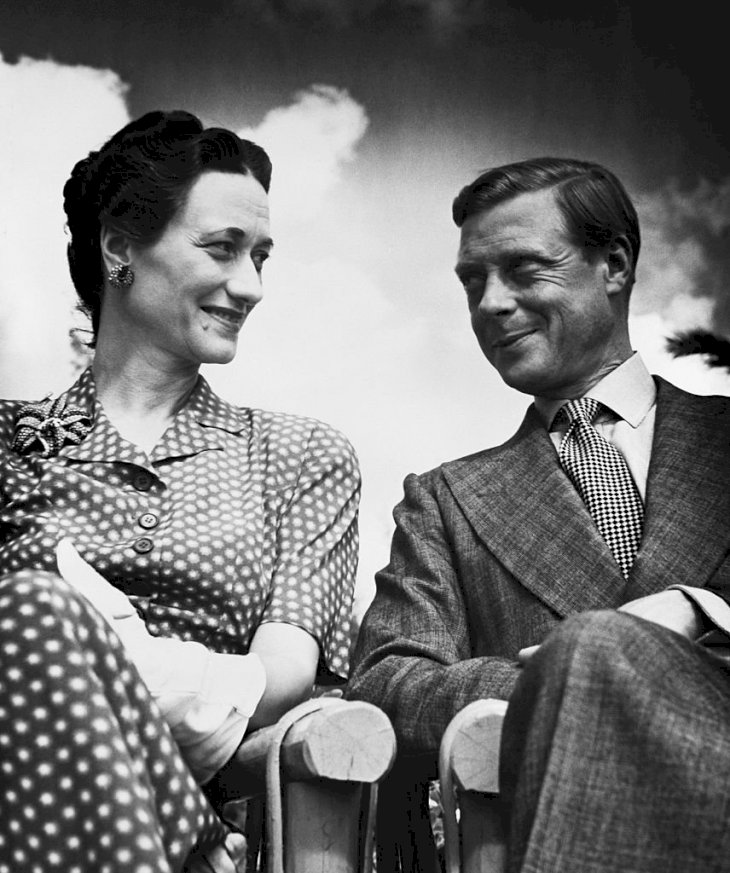 Image Credits: Getty Images / Bettmann | The Duke and Duchess of Windsor seated under an open sky.
