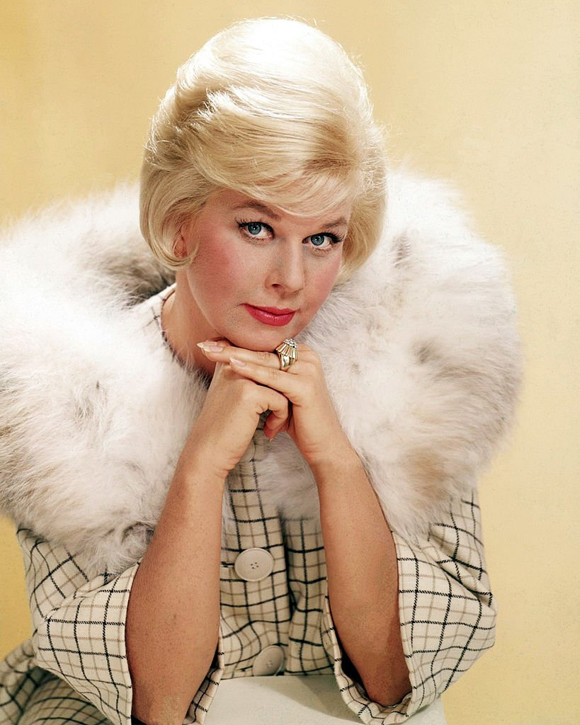 Image Credits: Getty Images / Silver Screen Collection | American actress Doris Day in a fur-trimmed coat, circa 1963.