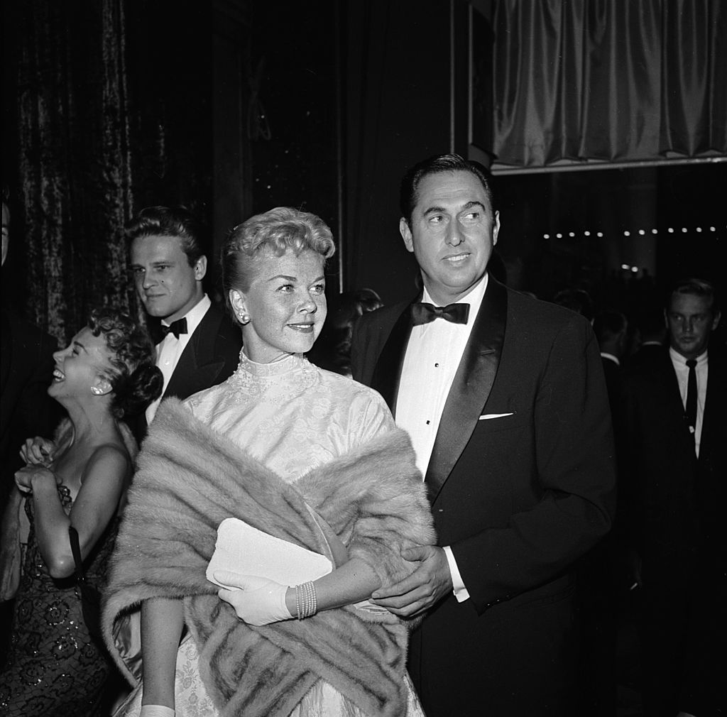 Image Credits: Getty Images / Jay Scott / BIPs | American actress Doris Day with husband Marty Melcher at the film premiere of 'A Star Is Born' featuring Judy Garland.