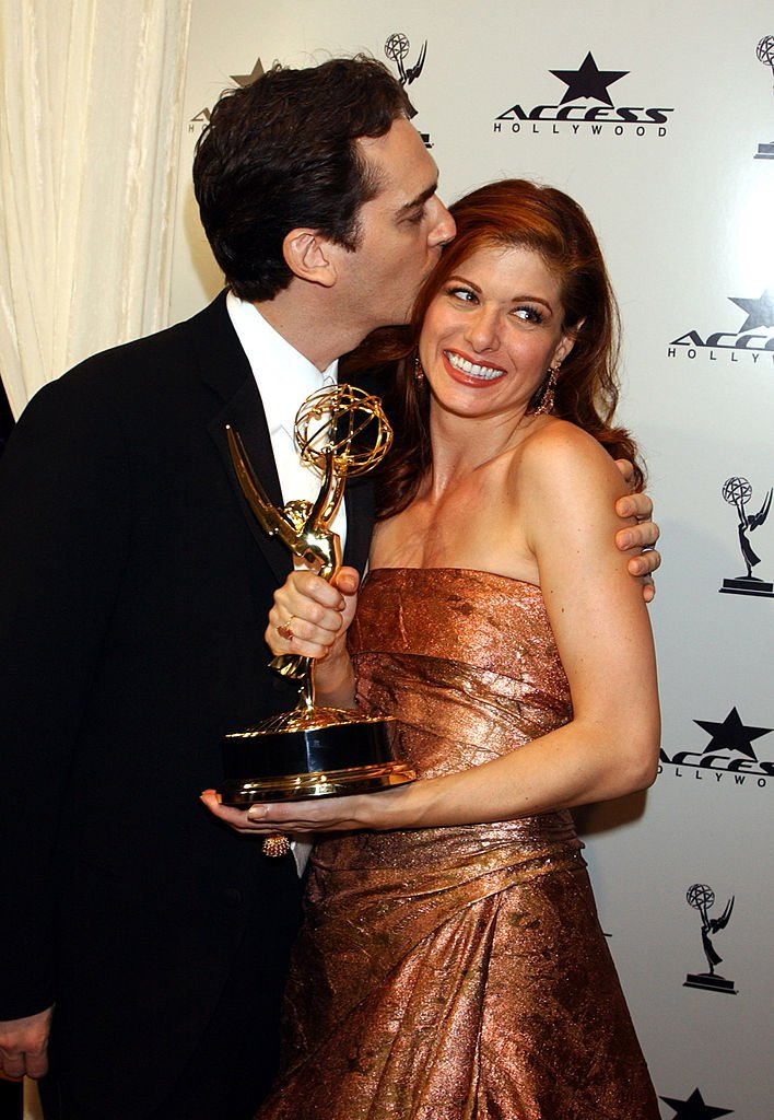 Image Source: Getty Images/George Pimentel| Debra Messing and husband Daniel Zelman with her Emmy for Outstanding Lead Actress in a Comedy Series for 'Will & Grace'