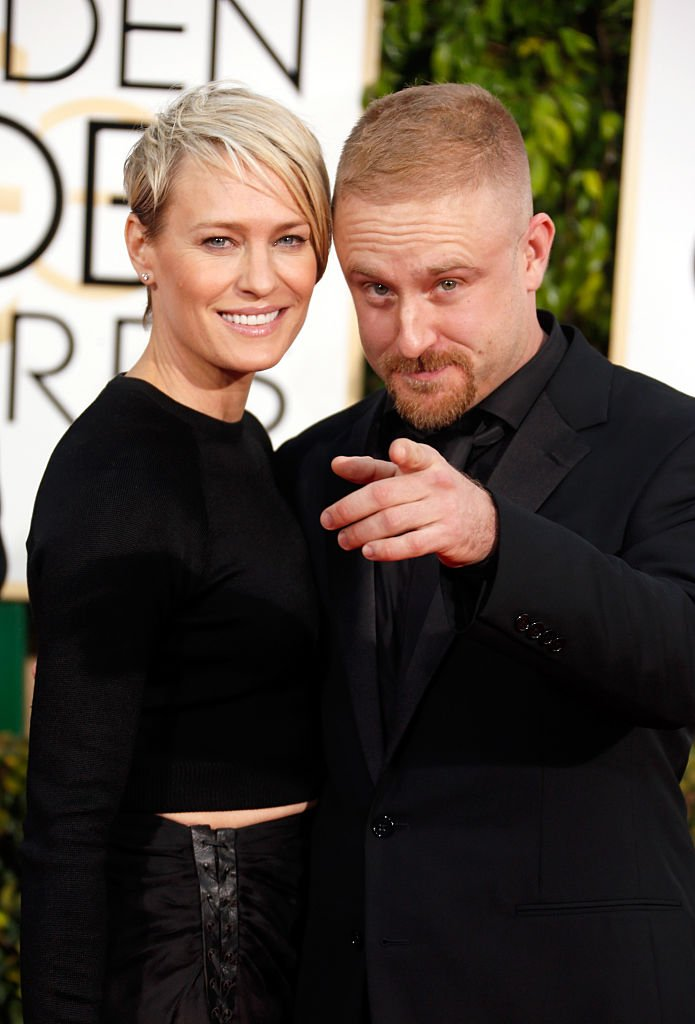 Image Source: Getty Images/Jeff Vespa/Actress Robin Wright (L) and actor Ben Foster attend the 72nd Annual Golden Globe Awards at The Beverly Hilton Hotel on January 11, 2015