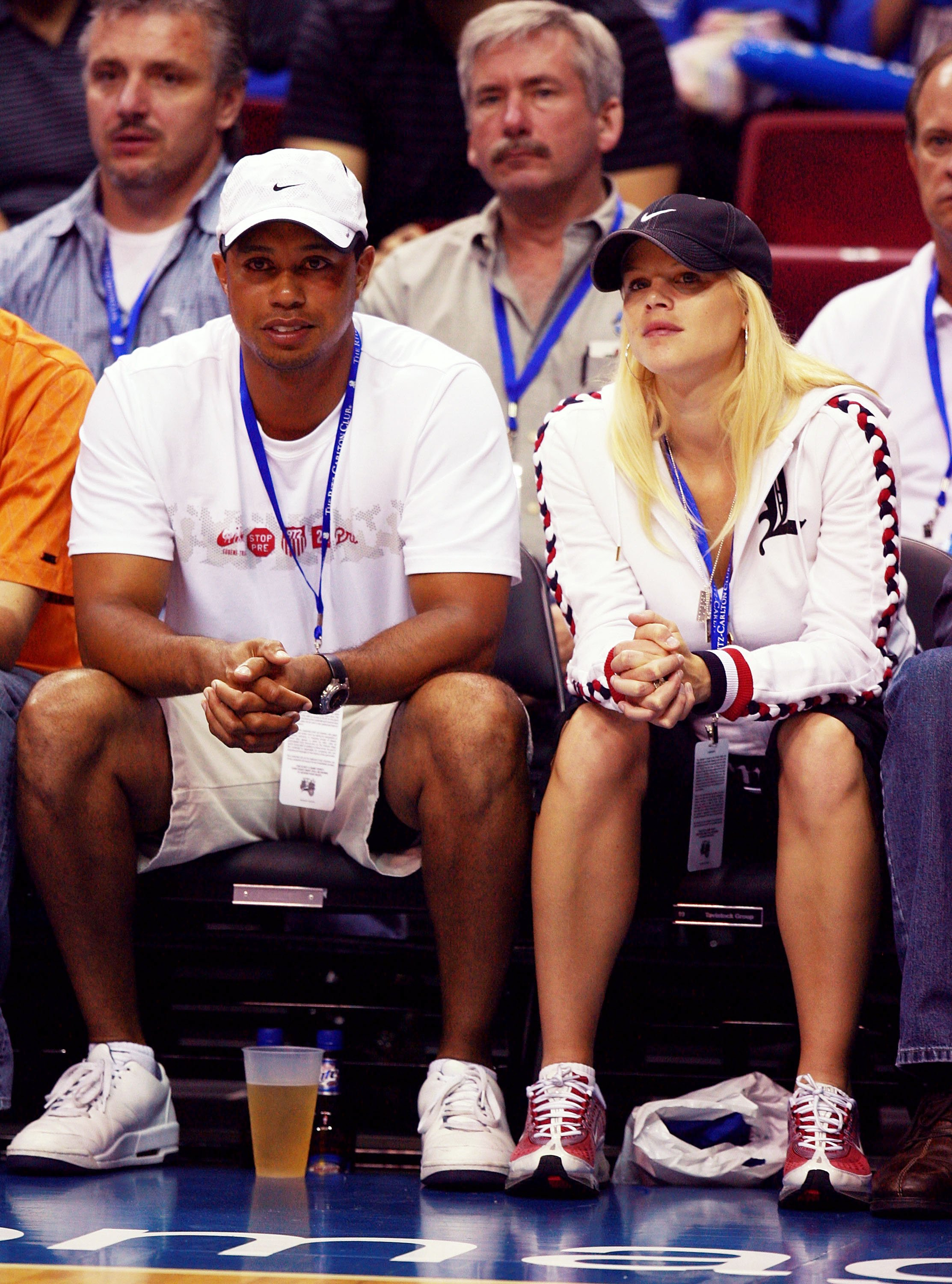 Image Credits: Getty Images / Doug Benc | Golfer Tiger Woods and wife Elin Woods watch the Orlando Magic take on the Detroit Pistons in Game 3 of the Eastern Conference Quarterfinals during the 2007 NBA Playoffs at Amway Arena on April 26, 2007 in Orlando, Florida.