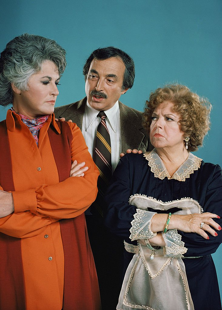 "Image Credits: Getty Images / CBS | ""Maude"" cast members, from left, Bea Arthur as Maude Findlay, Bill Macy as Walter Findlay and Hermione Baddeley as Mrs. Nell Naugatuck. Image dated August 1, 1974."