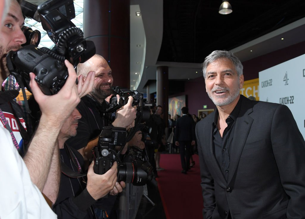 """Image Credit: Getty Images / George Clooney attends the """"Catch 22"""" UK premiere at the Vue Westfield on May 15, 2019 in London, United Kingdom."""
