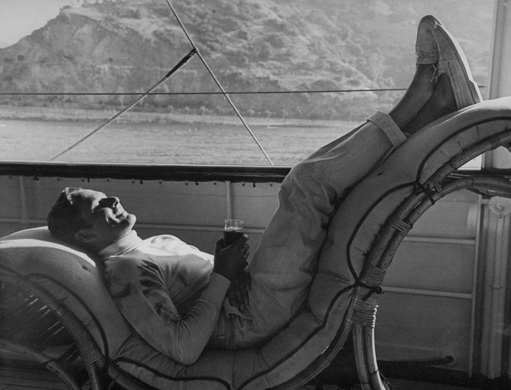 Image Source: Getty Images / Actor Errol Flynn (1909-1959), known as the king of swashbuckler films, on a boat.