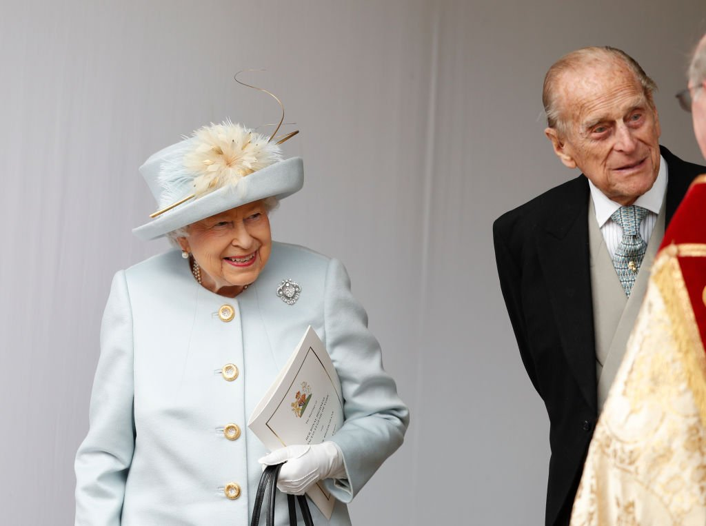 Image Credit: Getty Images / Queen Elizabeth II and Prince Philip, Duke of Edinburgh look on after the wedding of Princess Eugenie of York on October 12, 2018 in Windsor, England.