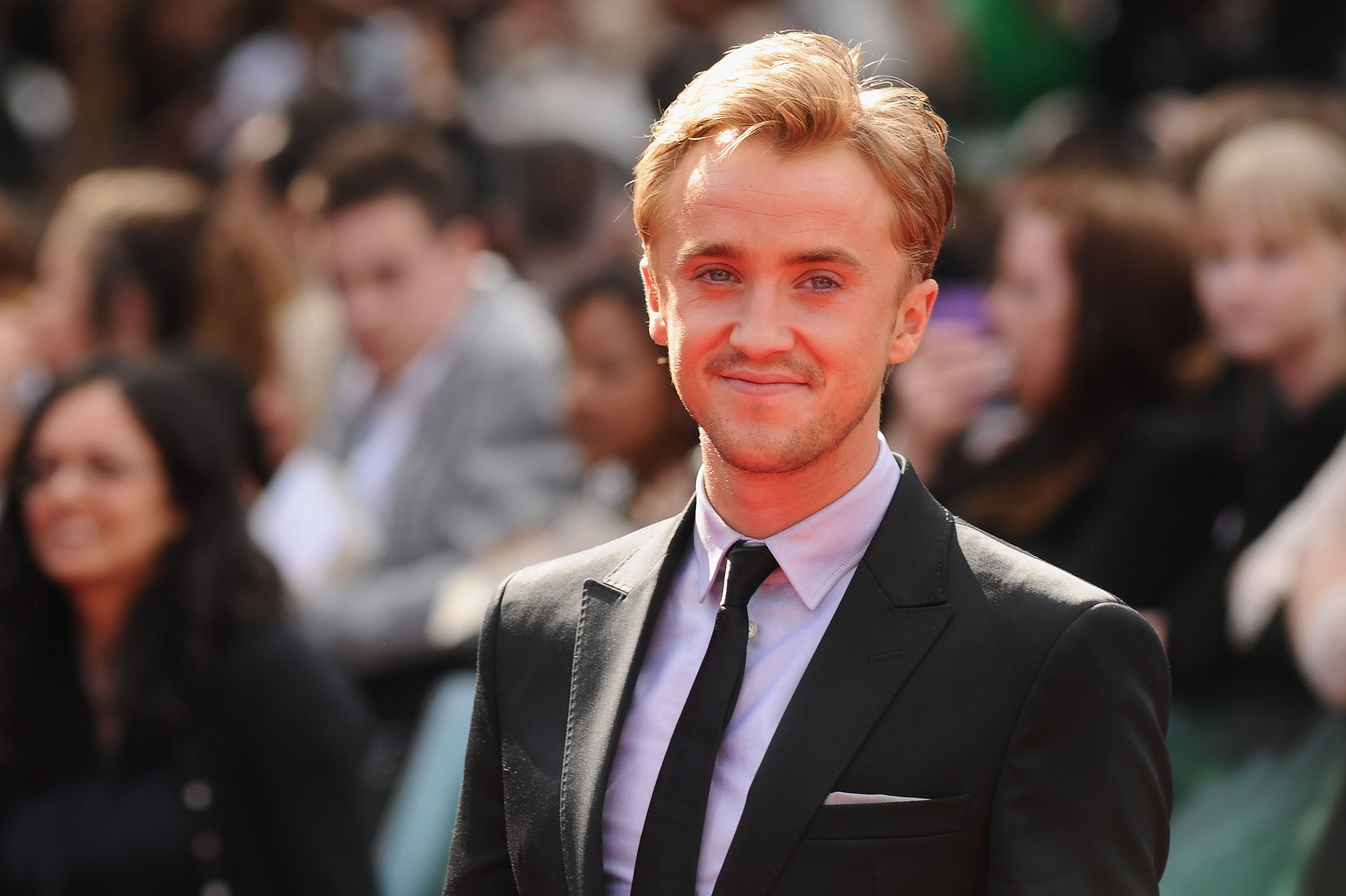 Actor Tom Felton attends the World Premiere of Harry Potter and The Deathly Hallows - Part 2 / Getty Images