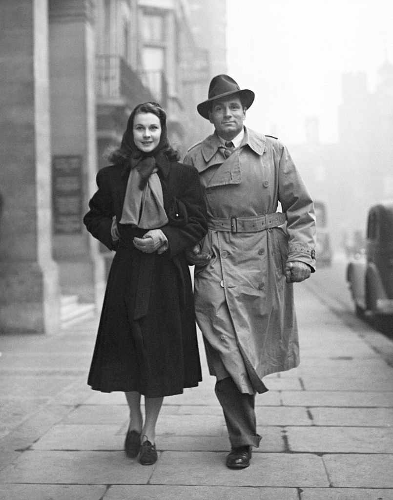 Image Credits: Getty Images / Hulton-Deutsch Collection/CORBIS | Vivien Leigh and Laurence Olivier walking down the street together