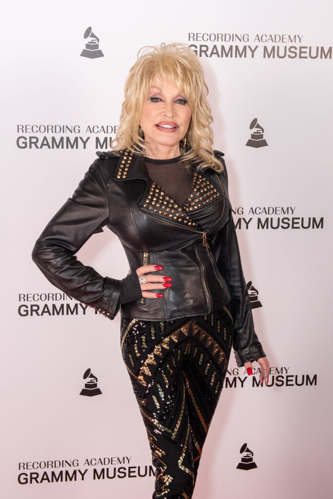 Image Credits: Getty Images / Timothy Norris / WireImage | Dolly Parton attends Dolly Parton Town Hall Program at The GRAMMY Museum on February 06, 2019 in Los Angeles, California.