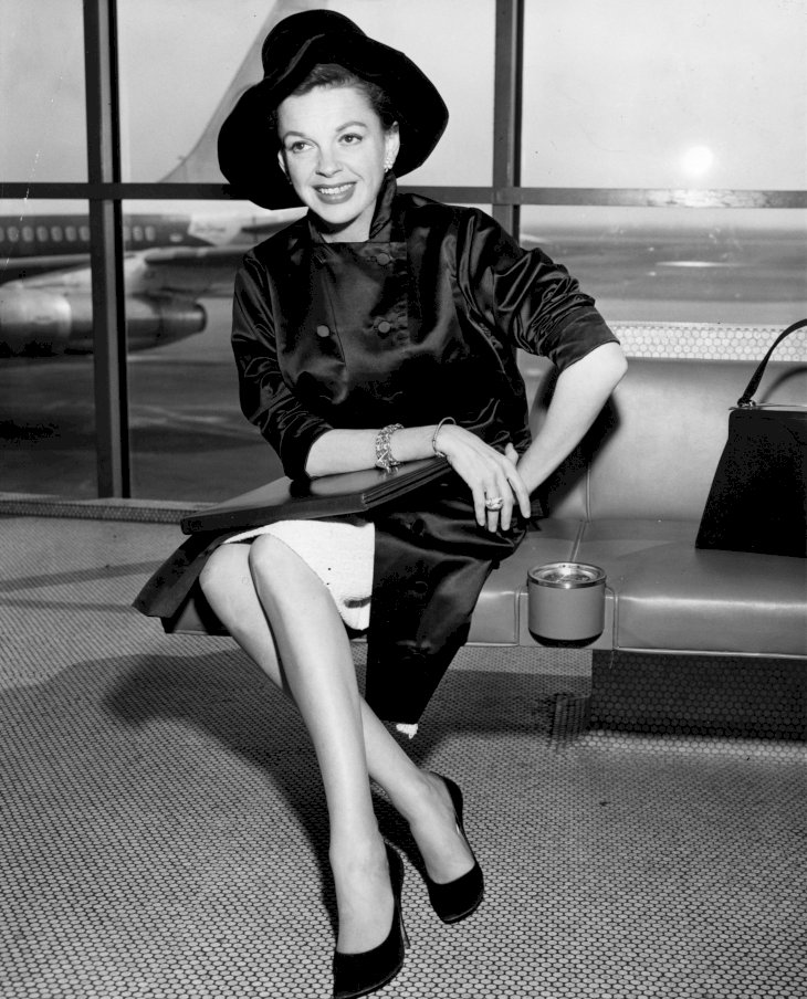 Image Credit: Getty Images/Keystone | Singer and film star, Judy Garland at an airport circa 1955.