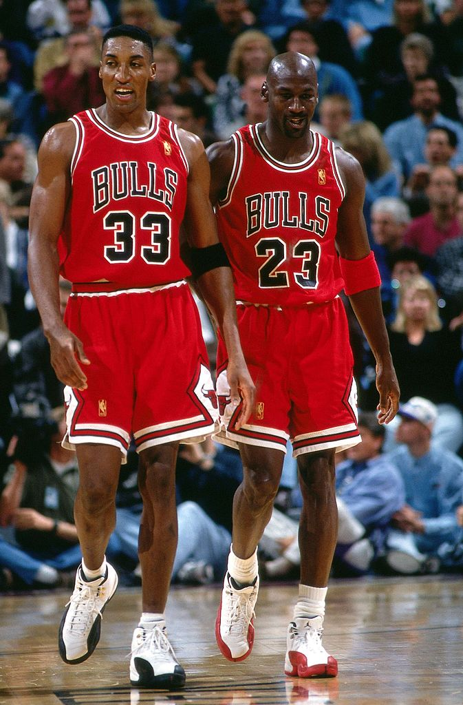 Image Credits: Getty Images / Andy Hayt / NBAE  | Scottie Pippen #33 and Michael Jordan #23 of the Chicago Bulls walk upcourt during a 1997 NBA game at the Delta Center in Salt Lake City, Utah.