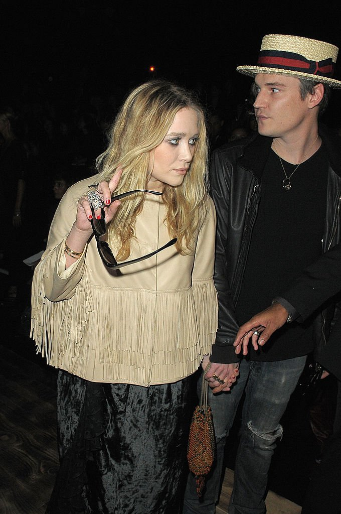 Image Credit: Getty Images/WireImage/Dominique Charriau | Mary-Kate Olsen and Max Winkler attend the Giambattista Valli Pret a Porter show