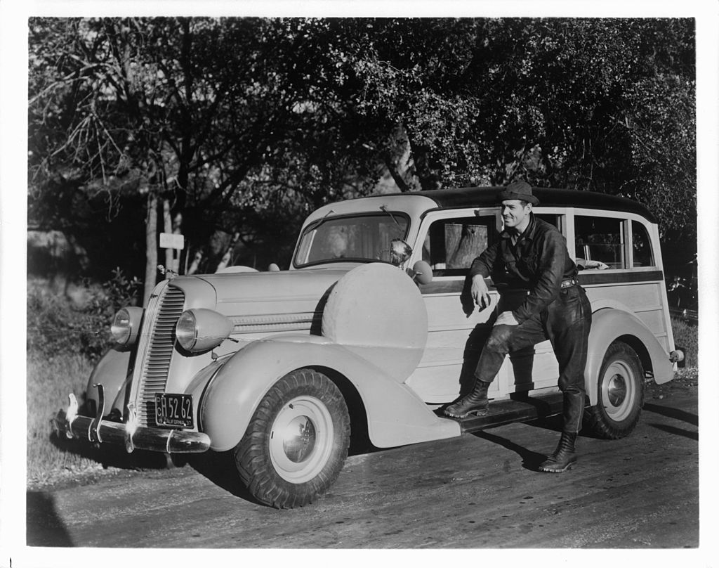 Image Credit: Getty Images / Clark Gable stands in front of a car in a publicity shot, Circa 1937.