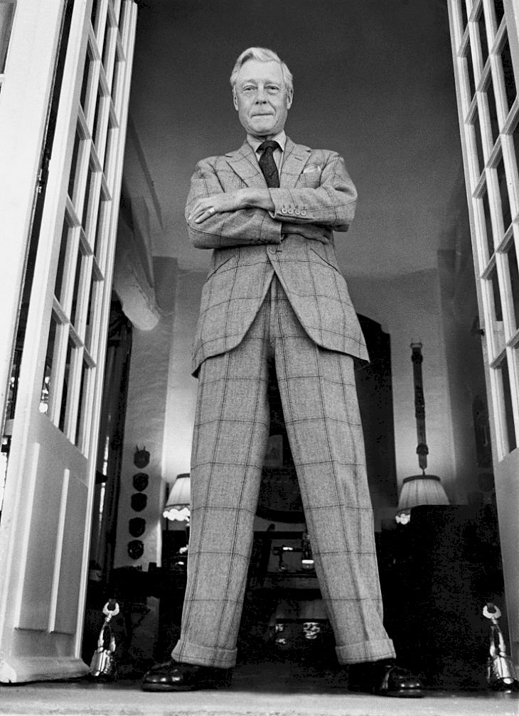Image Credits: Getty Images / Patrick Lichfield / Condé Nast | The Duke of Windsor (aka King Edward VIII) arms crossed, standing in a doorway of Moulin de la Tuileries, his home outside Paris.