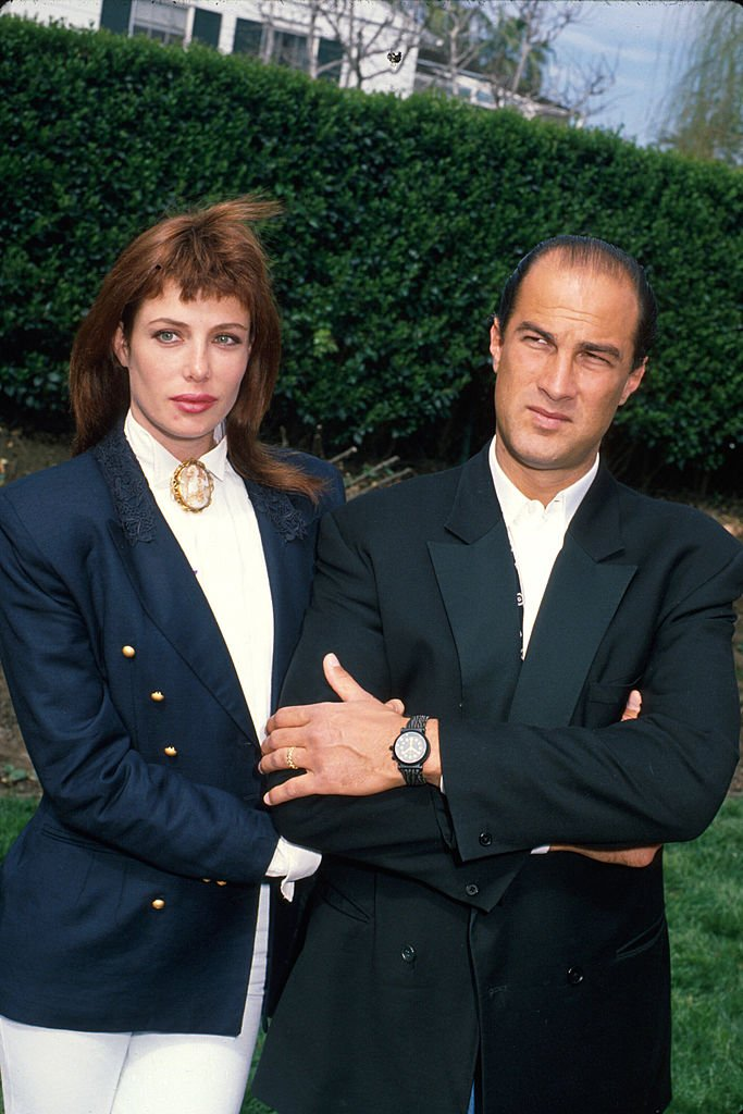 Image Credits: Getty Images / Kevin Winter / DMI / The LIFE Picture Collection | Married actors Kelly LeBrock and Steven Seagal.
