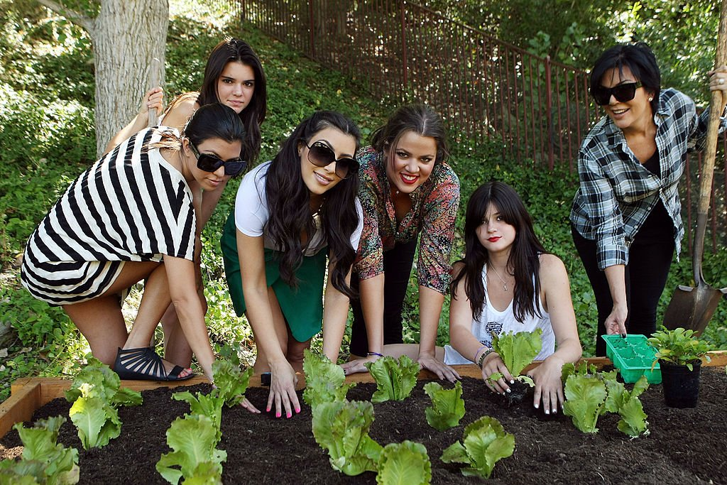 Image Credit: Getty Images / The Kardashians plant a vegetable garden at their family home on August 6, 2009 in Los Angeles, California.