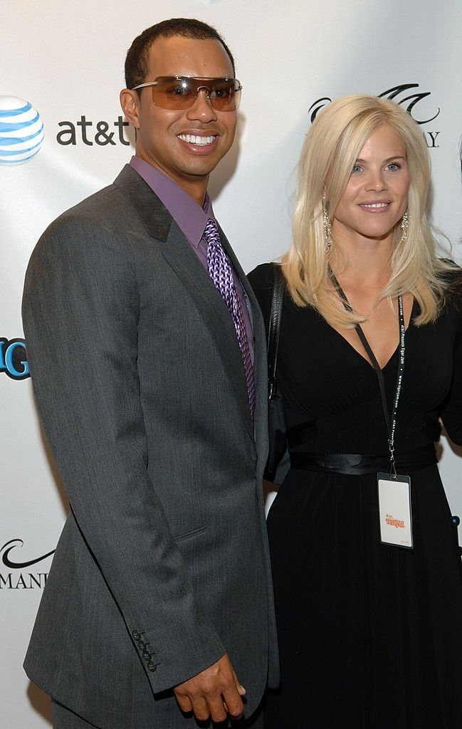 Image Credits: Getty Images / Lester Cohen Archive / WireImage | Tiger Woods and Elin Nordegren.