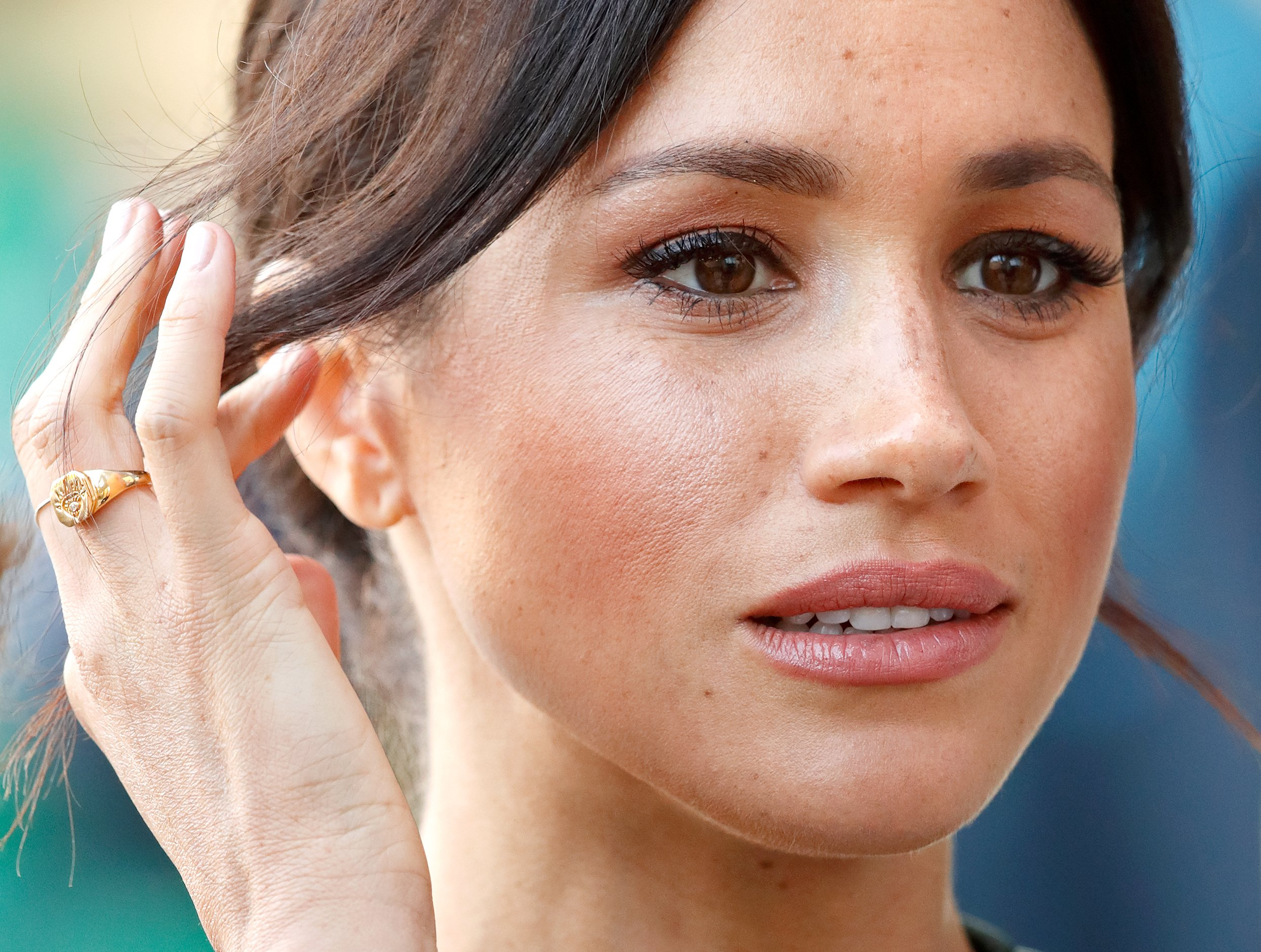 Image Credits: Getty Image | Meghan Markle is photographed by the press.