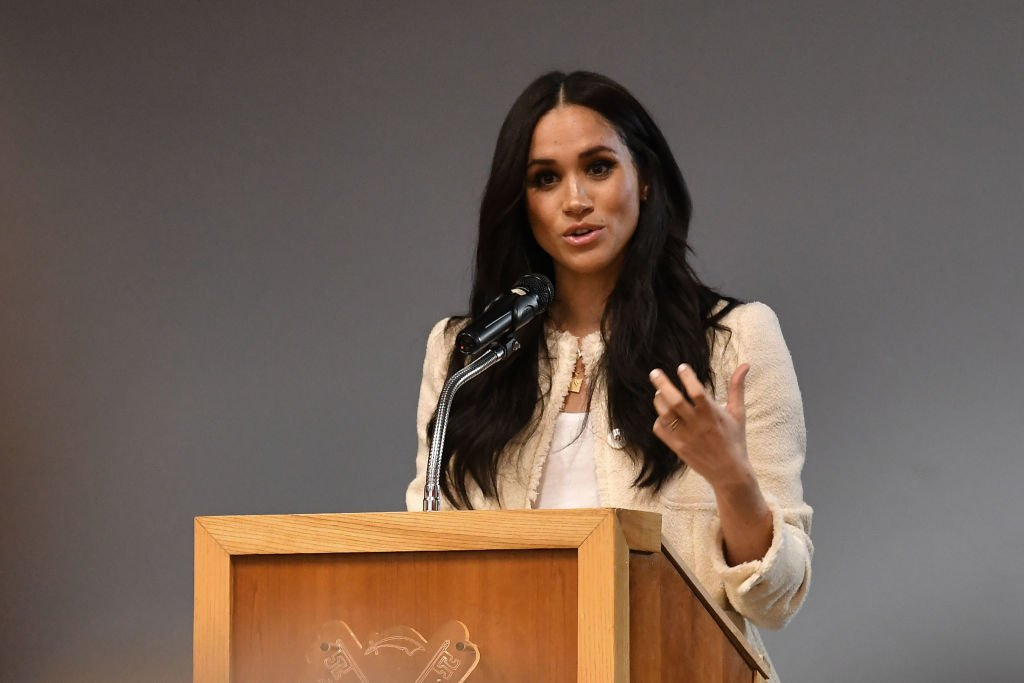 Image Credit: Getty Images / Meghan, Duchess of Sussex speaks during a special school assembly at the Robert Clack Upper School in Dagenham ahead of International Women's Day on March 6, 2020 in London, England.