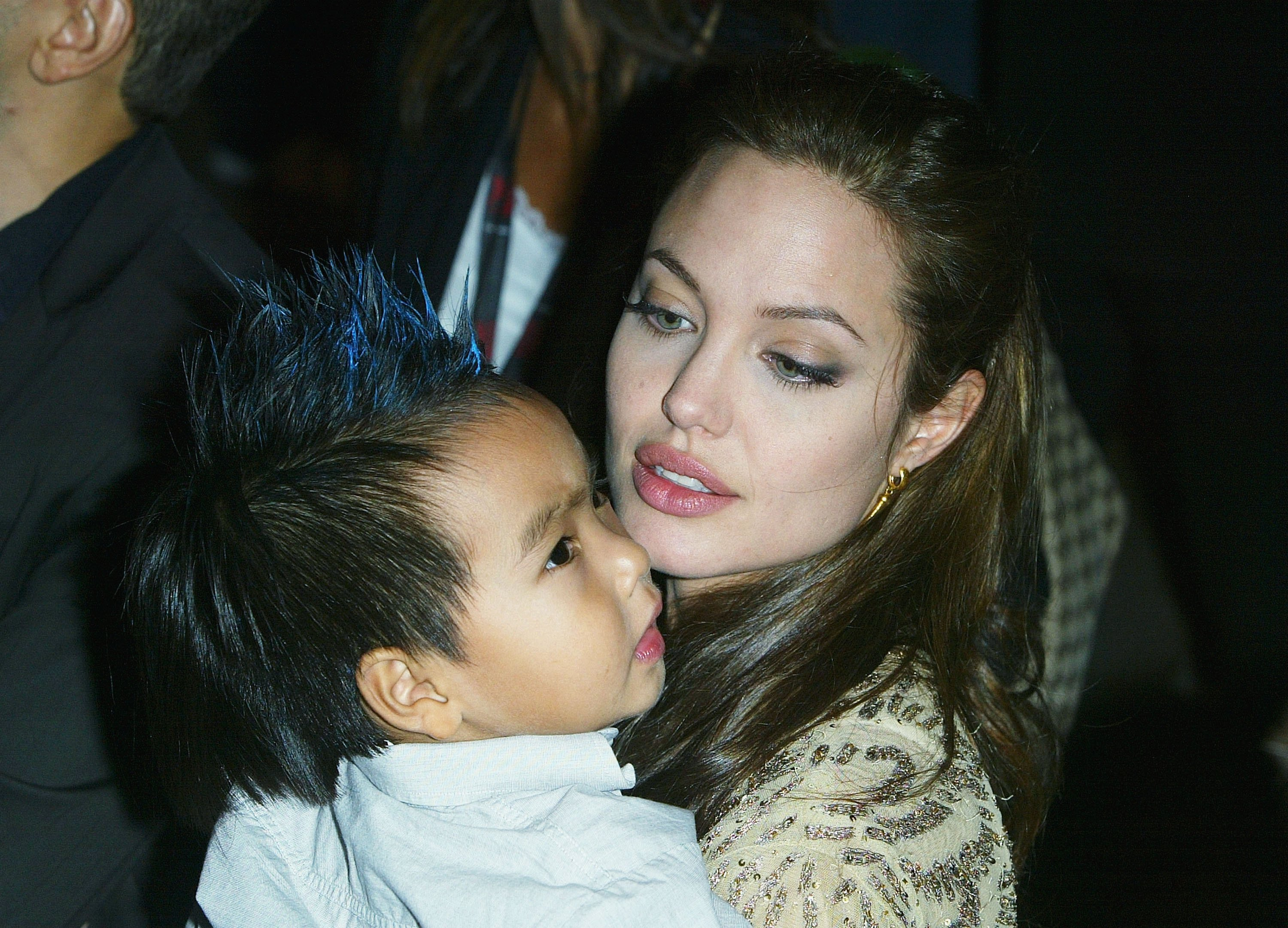 Image Source: Getty Images/Angelina holding her child