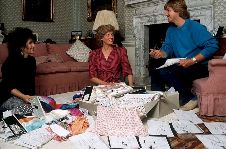 Image Credit: Getty Images/Tim Graham Photo Library via Getty Images | Princess Diana with her designers, The Emmanuels