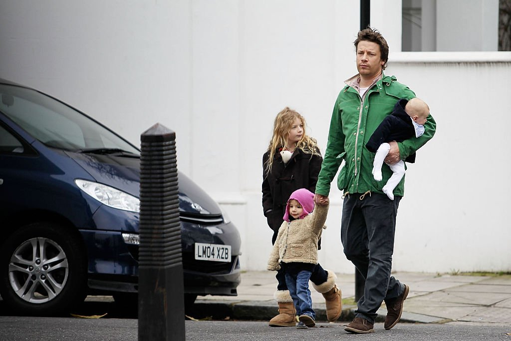 Image Credit: Getty Images / Jamie Oliver with his three young children Petal Blossom, Daisy Boo and Buddy Bear are seen on March 13, 2011 in London, United Kingdom.