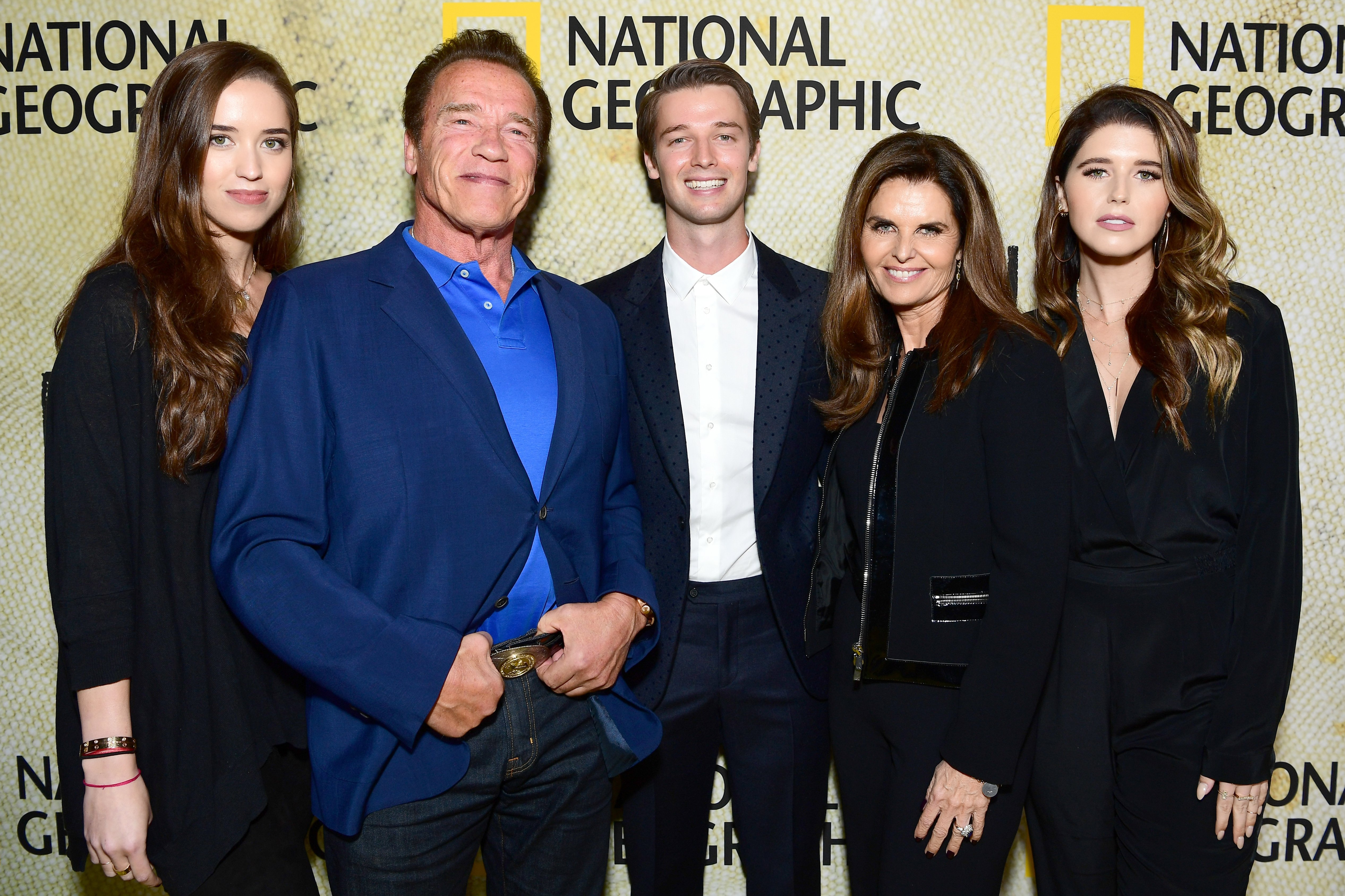 "Image Credits: Getty Images / Emma McIntyre | (L-R) Christina Schwarzenegger, Arnold Schwarzenegger, Patrick Schwarzenegger, Maria Shriver and Katherine Schwarzenegger attend the premiere of National Geographic's ""The Long Road Home"" at Royce Hall on October 30, 2017 in Los Angeles, California."