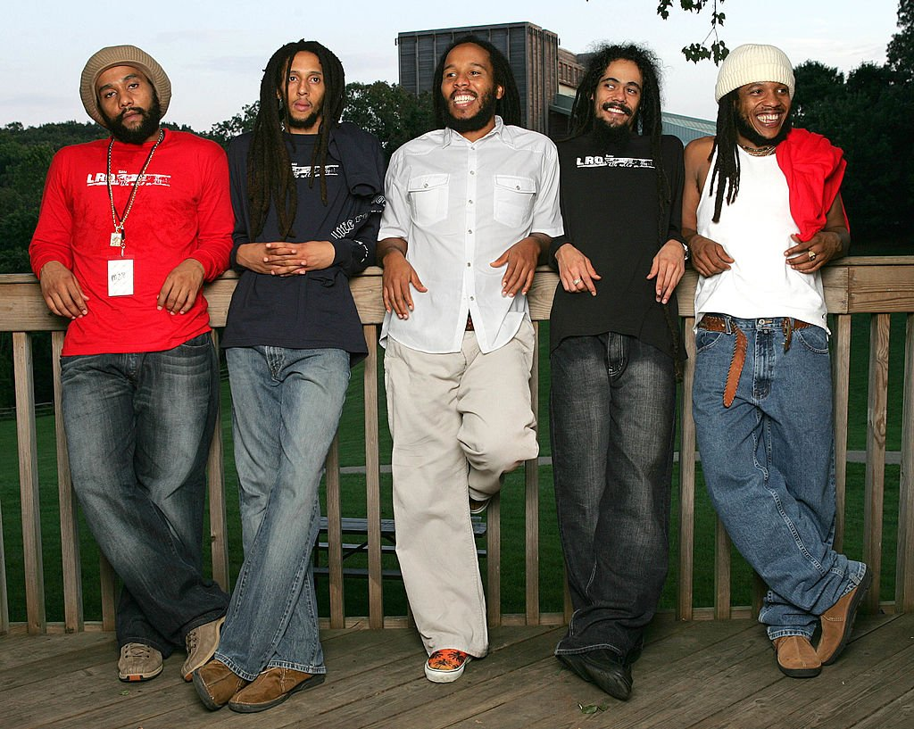 """Image Source: Getty Images/Frank Micelotta/Kymani, Julian, Ziggy, Damian and Stephen Marley sons of Bob Marley pose for a photo after their performance at the """"Roots, Rock, Reggae Tour 2004"""" at the Filene Center August 8, 2004 in Vienna, Virginia"""