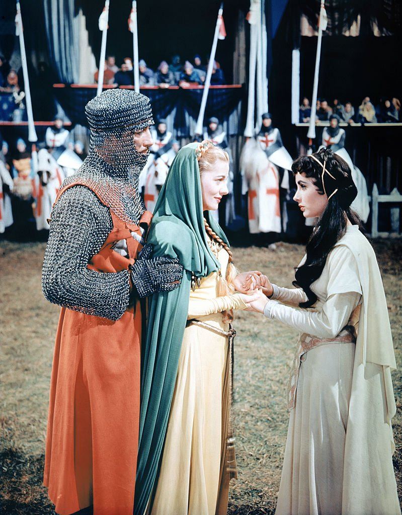 Image Source: Getty Images/Corbis/Sunset Boulevard/Colorised photo of Joan Fontaine with Elizabeth Taylor and Robert Taylor on the set of Ivanhoe