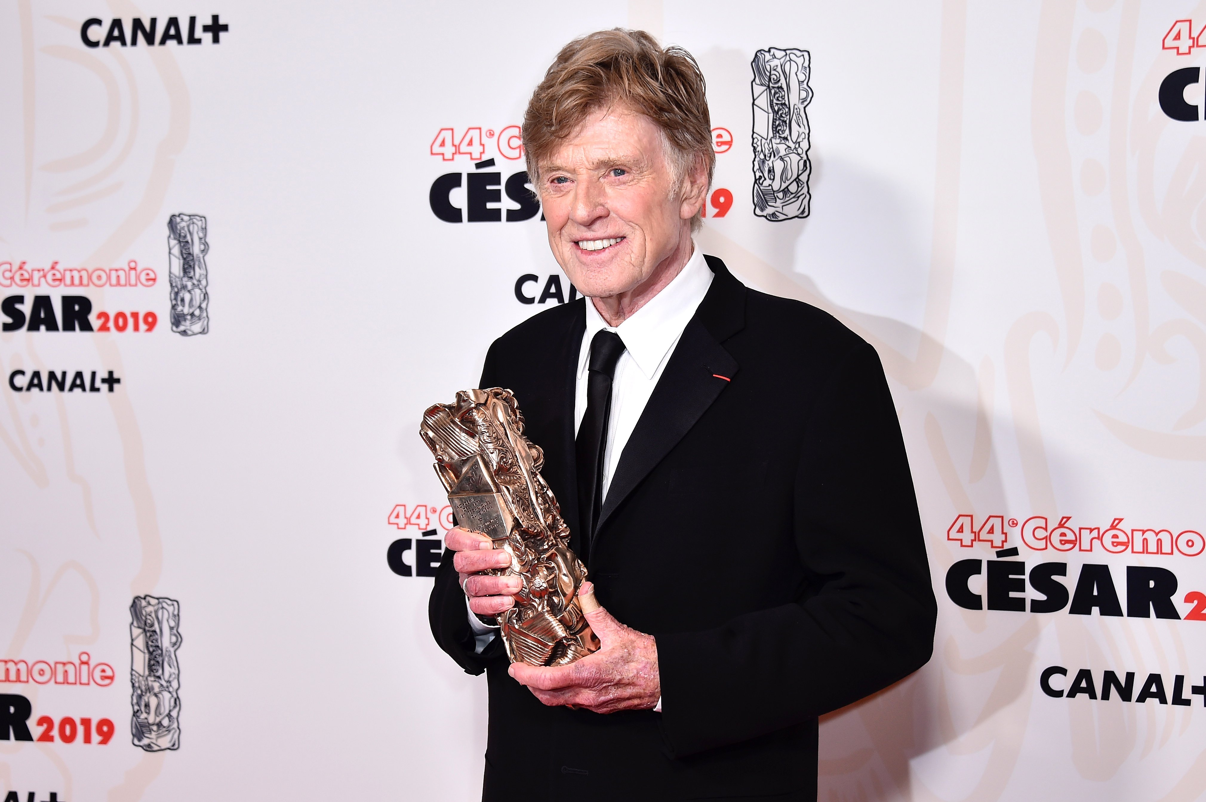 Image Credits: Getty Images / Kristy Sparow | Robert Redford poses with the Honorary Cesar award for his career during at Salle Pleyel on February 22, 2019 in Paris, France.