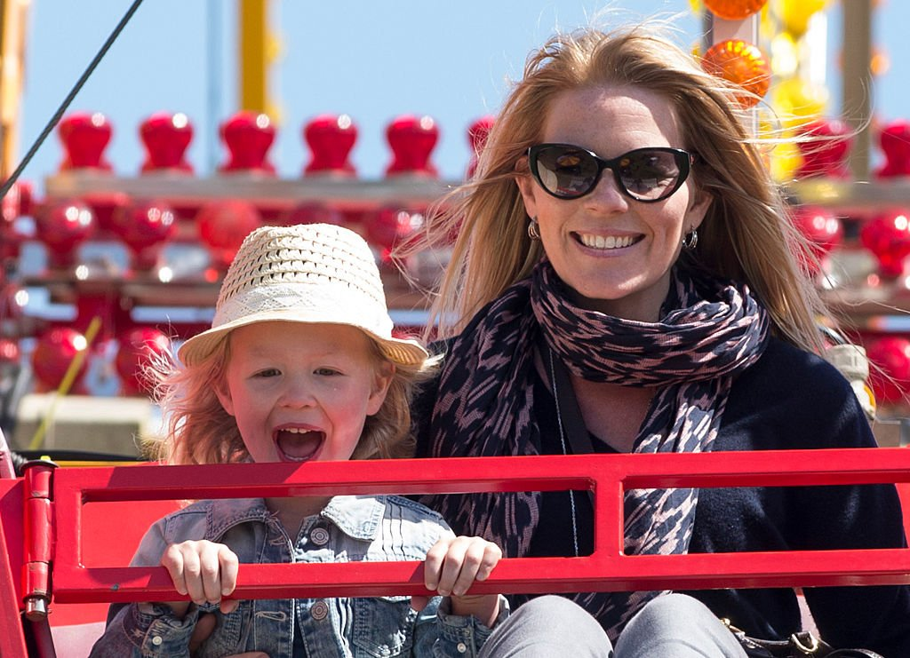 Image Credit: Getty Images / Autumn Phillips and Savannah Phillips on a Ferris wheel as they attend the Royal Windsor Horse show on May 16, 2015 in Windsor, England.