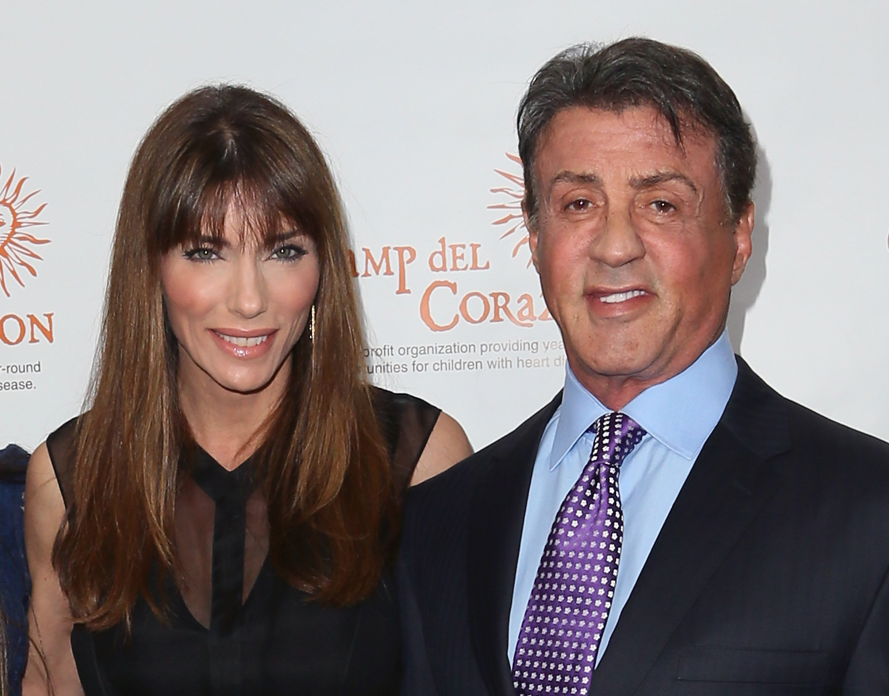 Image Credits: Getty Images / David Livingston | Actor Sylvester Stallone (R) and wife Jennifer Flavin attend Camp del Corazon's 11th Annual Gala del Sol at the Ray Dolby Ballroom at Hollywood & Highland Center on April 19, 2014 in Hollywood, California.