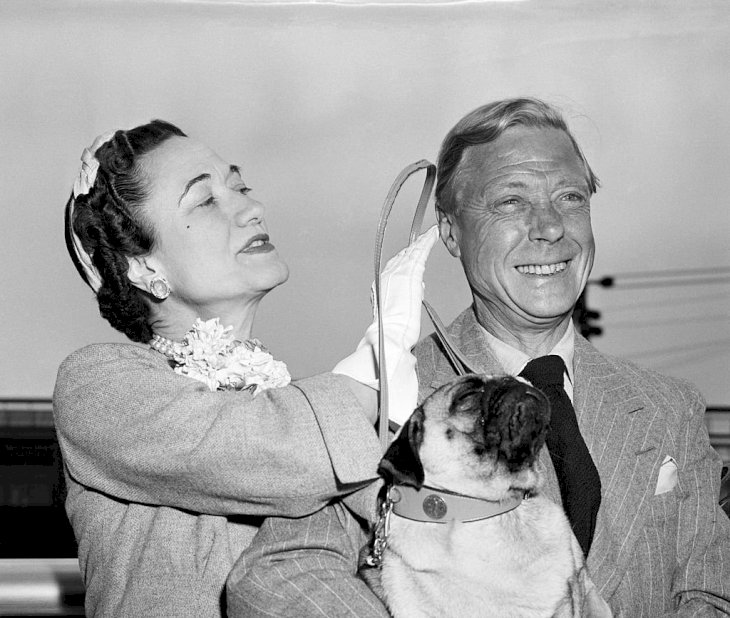 Image Credits: Getty Images / Bettmann | Duke and Dutchess of Windsir with pet dog, Trooper.