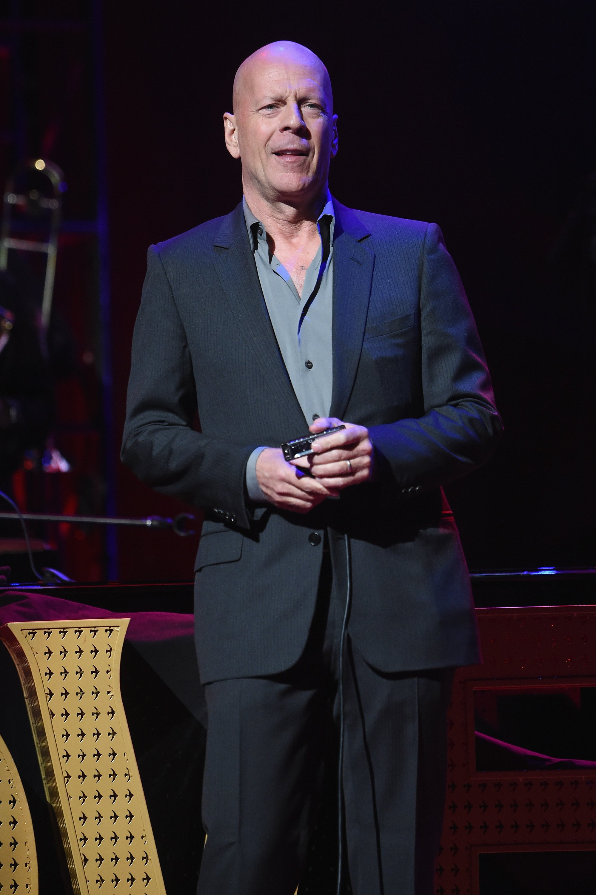 Images Source: Getty Images/Bruce Willis on stage
