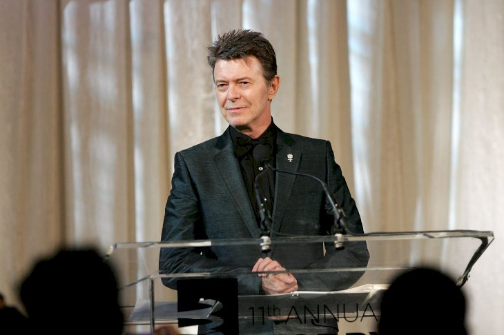 Image Credit: Getty Images / David Bowie giving a speech at an event.