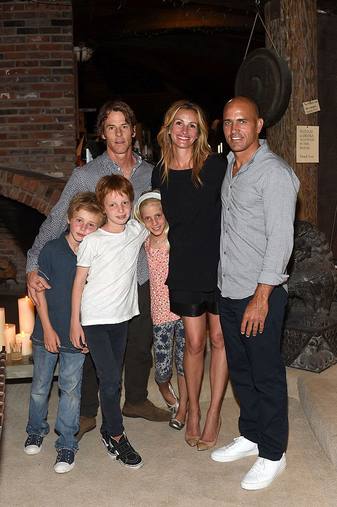 Image Credits: Getty Images / Stefanie Keenan | Daniel Moder, Julia Roberts, Kelly Slater, Phinnaeus Moder, Henry Daniel Moder and Hazel Moder attend Kelly Slater, John Moore and Friends Celebrate the Launch of Outerknown at Private Residence on August 29, 2015 in Malibu, California.