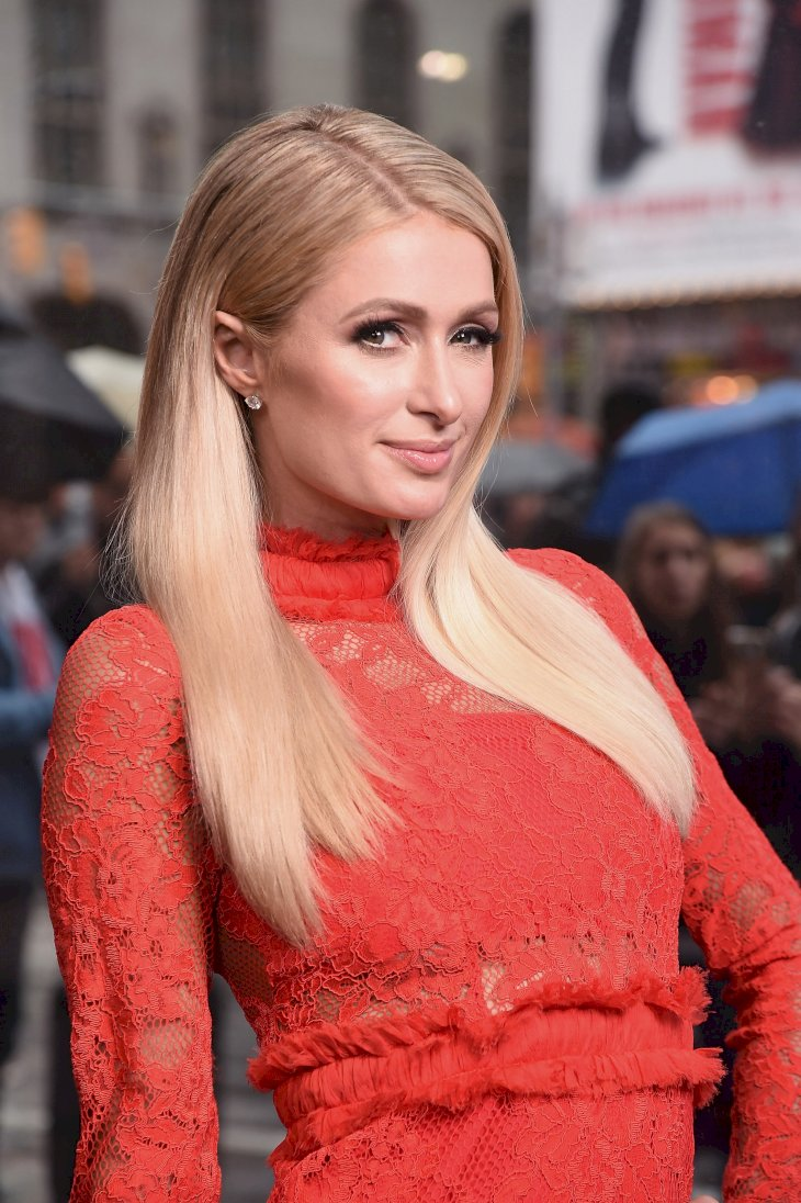 Image Credits: Getty Images / Gary Gershoff | Paris Hilton visits 'Extra' at The Levi's Store Times Square on May 13, 2019 in New York City.