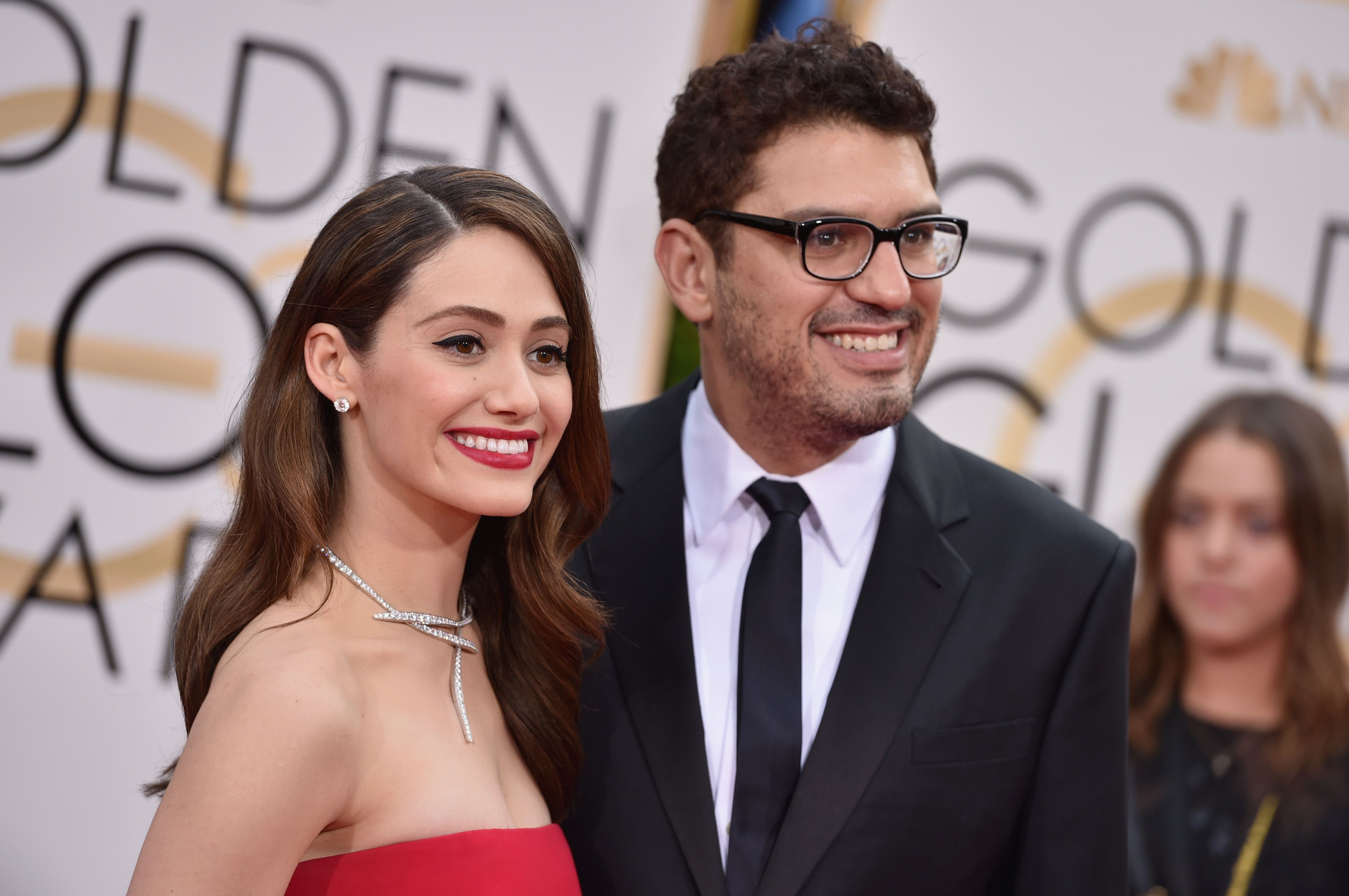 Sam Esmail and Emmy Rossum arrives at the 73rd Annual Golden Globe Awards / Getty Images