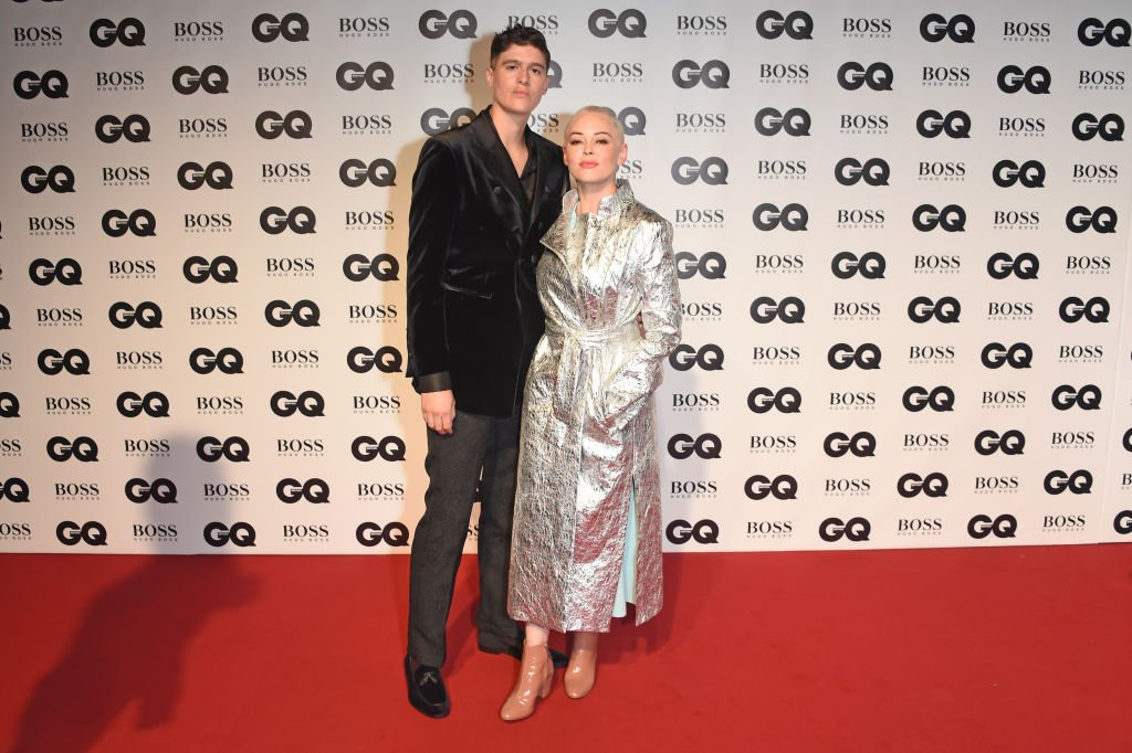 Image Credit: Getty Images / Rain Dove (L) and Rose McGowan attend the GQ Men of the Year Awards 2018 in association with HUGO BOSS at Tate Modern on September 5, 2018 in London.