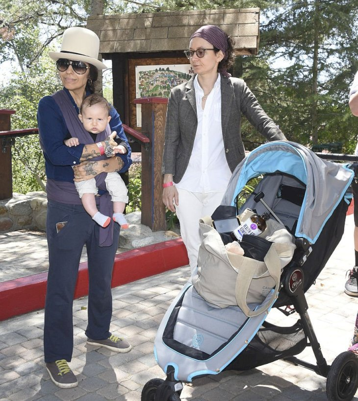 Image Credit: Getty Images/Michael Bezjian | Linda Perry and actress Sara Gilbert attend Amazon Video's Tumble Leaf Family Fun Day with their kids