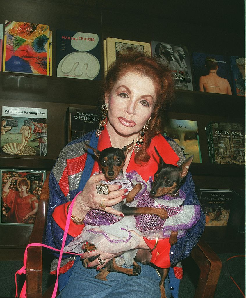 "Image Credits: Getty Images / David Keeler / Newsmakers | Astrologer extraordinaire Jacqueline Stallone and her psychic dogs attend an event at Barnes & Noble bookstore to present ""Jacqueline Stallone's Starpower"" September 14, 2000 in Encino, CA."